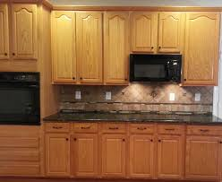 kitchen backsplash ideas with oak cabinets honey oak cabinets with verde butterfly countertops backsplash is