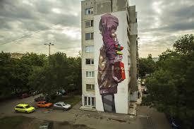 these polish street artists create amazing building size paintings etam cru