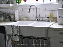 cottage style kitchen with ruvati pullout kitchen faucet