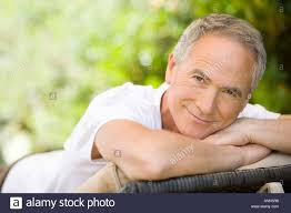 Chair In Garden Middle Aged Man Relaxing On Deck Chair In Garden Portrait Stock