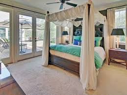 traditional master bedroom with crown molding u0026 french doors in