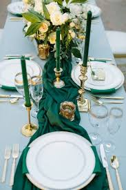 emerald green table runners picture of a wedding table setting with emerald candles napkins and