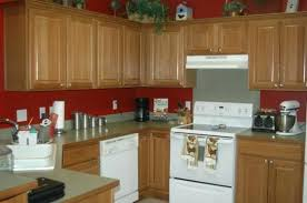 brown wall paint and orange kitchen cabinets kitchen paint ideas