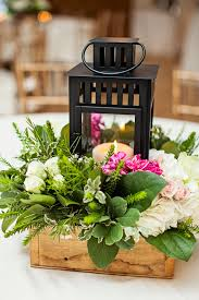 lantern centerpieces bright idea lantern floral arrangements fiftyflowers the