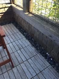 wood deck tiles with river rock edge wilson pinterest wood