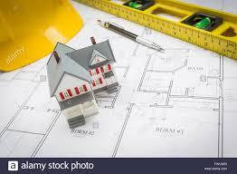 Custom House Blueprints Model Home Level Hard Hat And Pencil Resting On Custom House