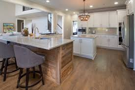 creative cabinets and design bright white raised panel cabinets and reclaimed wood peninsula with