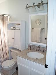 Small Bathroom Sinks With Storage White Wooden Cabinet With Door Above White Toilet Beside