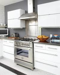 white cabinets with stainless steel tiles design ideas
