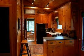 shaped kitchen island made of cedar tree designs pinterest kitchens with cedar walls walls in dark green with ceiling