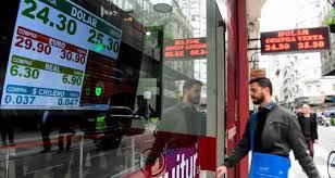 bureau de changes argentine peso falls to record low