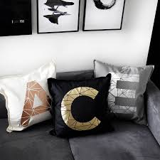 personalised metallic initial letter cushions by pushka home