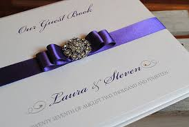 purple wedding guest book guest book in cadbury purple with sparkly brooch and