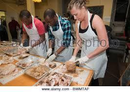 volunteers serve thanksgiving dinner in the primarily