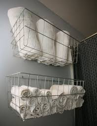 Towel Storage For Bathroom by Use Wire Baskets For Bathroom Towel Storage Genius For The