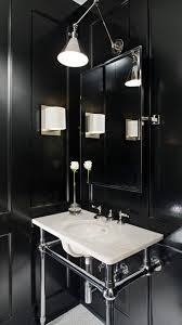 amazing bathroom with white vanity arch wall lamp and balck wall