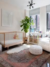 pink and gray vintage rug in nursery transitional nursery