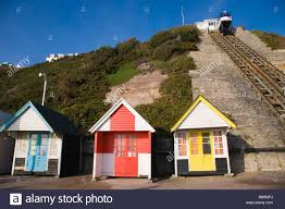 beach huts and the car of the west cliff lift funicular railway