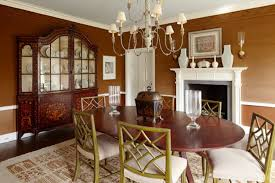 dining room with brown wall colors team up with elegant hutch and