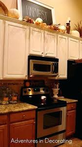 decorating ideas for above kitchen cabinets the cabinet decor ideas ideas above kitchen cabinets 2