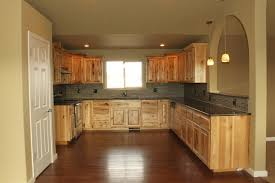hickory cabinets with granite countertops kitchen west ridge view estates traditional kitchen omaha