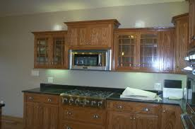 mission oak kitchen cabinets raised microwave flanked by glass cabinets kitchens pinterest