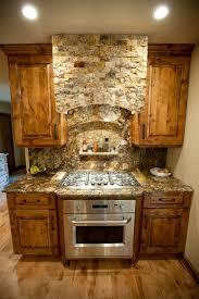 split face tile on kitchen hood rustic alder cabinets maple wood