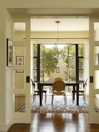 pocket door alternatives dining room transitional with wood