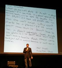 neil degrasse tyson with a letter he received from a
