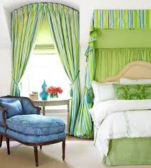striped curtains and green blind and curved rod panel arched