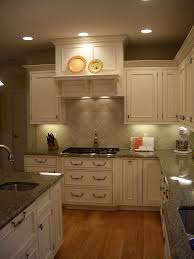 gourmet kitchen white cabinets full inset granite green