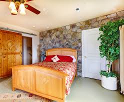 exotic bedroom exotic bedroom interior with stone wall trim wooden bed and stock