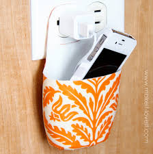 holder for charging cell phone made from lotion bottle cool