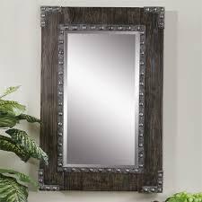 nail studded wood mirror rustic retreat