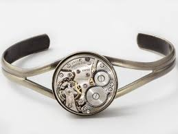 gold silver cuff bracelet images Steampunk cuff bracelet featuring a silver watch movement with an jpg