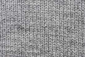 grey knitting background of handmade woolen pattern stock photo