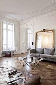 the perfect parisian apartment dark walls oversized gold framed