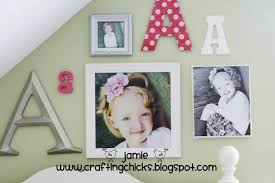 diy kid room decor monogram photo wall the crafting