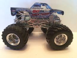 monster trucks grave digger bad to the bone wheels monster jam monster truck 1 64 metal base amsoil shock
