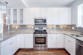 kitchen kitchen backsplash white cabinets black countertop