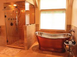 rustic master bathroom with freestanding bathtub by