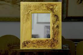 specchi con cornice specchio con cornice in legno con ulivo disegnato a pirografo