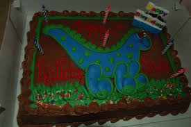 dinosaur birthday cake 6 year s dinosaur birthday cake from costco has 666 written