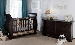 nursery room with espresso dresser and sleigh crib elegant and