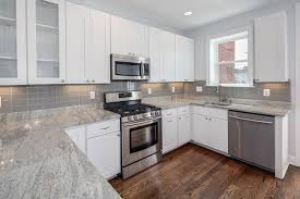 kitchen white kitchen cabinets with gray granite countertops