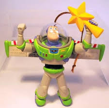 buzz lightyear holding yellow tree topper ornament grolier
