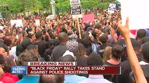 black friday shootings hundreds take to the streets for black friday rally in campus