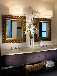bahtroom pretty flower decor between interesting square mirror on