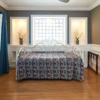 furniture vintage iron bed with pop up trundle placed on wooden