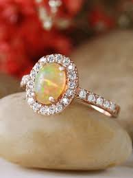 opal and engagement ring 7x5mm oval opal halo engagement ring